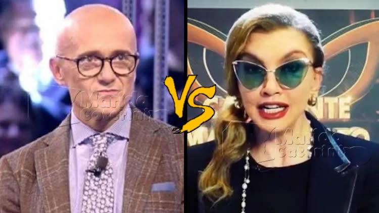 Signorini vs Carlucci le mosse segrete del GF Vip contro Il Cantante mascherato